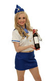 Air steward with wine bottle Stock Photography