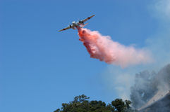Air tanker making water drop. California Department of forestry tanker making retardant drop on vegetation fire Mendocino County, Calif Royalty Free Stock Image