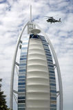 Air Taxi, at Burj Al Arab. Burj Al Arab hotel one of the luxurious hotel in the world uses helicopter as taxi. One of the helicopter landing on the helipad Royalty Free Stock Photos
