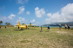 Air Taxi and Cruise Ship: Mystery Island Transport. MYSTERY ISLAND, VANUATU, PACIFIC ISLANDS: DECEMBER 2,2016: Air taxi, cruise ship, and tropical landscape with Royalty Free Stock Image