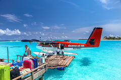 Air taxi landed close to  one of maldives islands, irufushi Royalty Free Stock Photography
