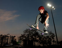 On Air - A teenager jump. A teenager doing some skateboard jumps at Kfar-Sava skate park Royalty Free Stock Photo