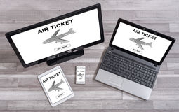 Air ticket booking concept on different devices. Air ticket booking concept shown on different information technology devices Stock Image