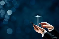 Air ticket booking and travel insurance app. Air ticket booking on smartphone app or online travel insurance concepts. Person with smart phone and symbol of a royalty free stock photography