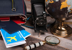 Air ticket, globe and bag on wood background royalty free stock images