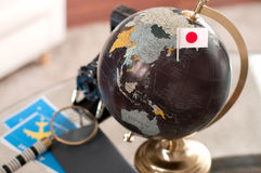 Air ticket and Japanese flag on globe stock photo
