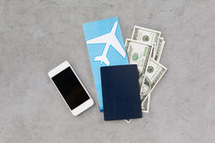 Air ticket, money, smartphone and passport Stock Images