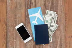 Air ticket, money, smartphone and passport Royalty Free Stock Photos