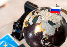 Air ticket and Russian flag on globe Royalty Free Stock Image