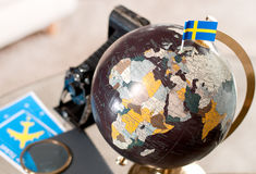 Air ticket and Swedish flag on globe Royalty Free Stock Photography