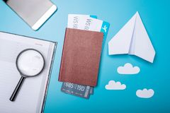 Air tickets with passport and paper plane on blue background, to. Pview. Bright Pastel background. The concept of air travel and holidays Royalty Free Stock Image