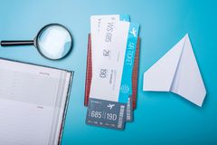 Air tickets with passport and paper plane on blue background, to. Pview. Bright Pastel background. The concept of air travel and holidays Stock Photography