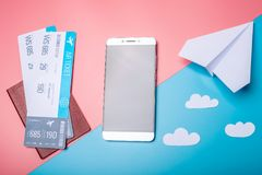 Air tickets with passport and paper plane on pastel background, topview. The concept of air travel and holidays. Air tickets with passport and paper plane on Royalty Free Stock Photos