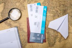 Air tickets with passport and paper plane on world map backgroun. D, topview. Bright Pastel background. The concept of air travel and holidays Stock Images