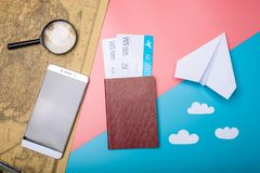 Air tickets with passport and paper plane on world map backgroun. D, topview. Bright Pastel background. The concept of air travel and holidays royalty free stock photography