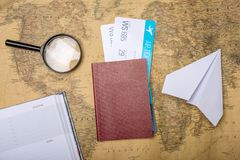 Air tickets with passport and paper plane on world map backgroun royalty free stock photos