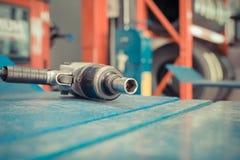Air tools at car garage Stock Images