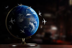 Air traffic around the Globe. All airplanes of the World on a desk Royalty Free Stock Photos