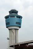 Air Traffic Control Tower. An air traffic control tower at an airport on a stormy looking day Royalty Free Stock Photos