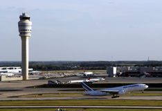 Air traffic control tower. An Air France jet takes off next to the control tower at  the worlds busiest Atlanta Hartsfield Jackson Airport Royalty Free Stock Photos