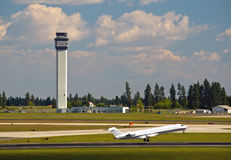 Air Traffic Control Tower and an Airplane. Taking Off Royalty Free Stock Photography