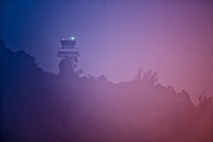 Air traffic control tower in dense fog Royalty Free Stock Photos
