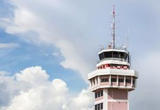 Air traffic control tower in international airport. On blue sky background Stock Photo