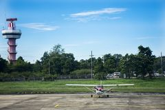 Air Traffic Control tower and Small plane stop on runway at Ubon Ratchathani International Airport. On September 17, 2017 in Ubon Ratchathani, Thailand Royalty Free Stock Photo