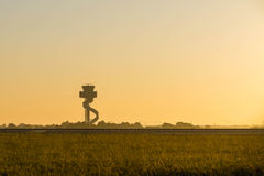 Air traffic Control Tower at sunrise. Royalty Free Stock Image