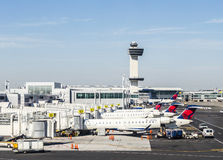 Air Traffic Control Tower and Terminal 4 with Air planes Royalty Free Stock Photos