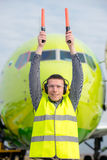 Air traffic controller. Holding light signs at the airport Stock Photo