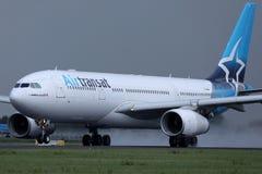 Air Transat jet landing on the runway stock photography