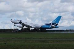 Air Transat jet landing on the runway royalty free stock photo