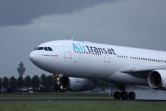 Air Transat jet landing on the runway. Airport, touching down royalty free stock photos