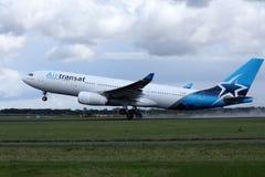 Air Transat jet landing on the runway stock photos