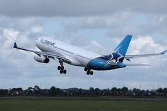 Air Transat jet taking off from runway royalty free stock images