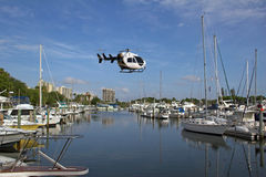 Air transport helicopter over marina Stock Photos