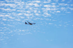 Air transport, Passenger airplane in the clouds. Royalty Free Stock Photo
