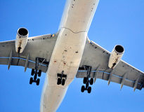 Air transportation: passenger airplane. Passenger airliner on final approach, seconds before touchdown Stock Images