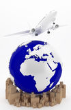 Air transportation in USA. The airplane as a symbol of international transport. A plane flies over Europe Royalty Free Stock Photo