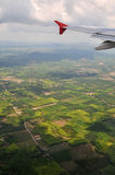 Air Travel. Flying over lush green landscape Royalty Free Stock Images