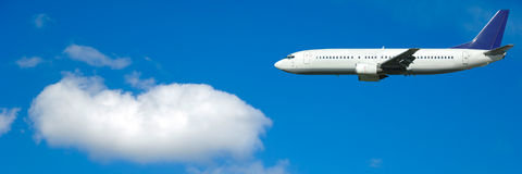 Air travel. Plane and cloud on blue sky Royalty Free Stock Photography