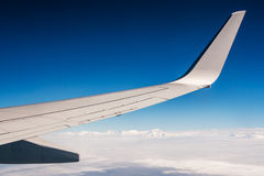 Air travel above clouds and mountains Stock Image