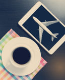 Air travel agency booking on tablet. In coffee shop royalty free stock image
