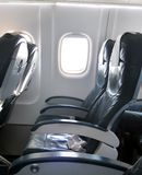 Air travel. Airplane cabin with empty seats stock photo