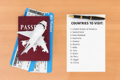 AIr Travel Concept. Airplane, Passport, Tickets, Pen and Paper w. Ith Countries to Visit List on a wooden table. 3d Rendering Stock Photo