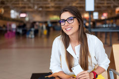 Air travel concept. Young woman with hand luggage and modern technology. Royalty Free Stock Image