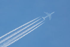 Air travel contrails Royalty Free Stock Photography