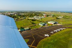 Air travel in Fiji, Melanesia, Oceania. View of hangars, helicopters and small planes on Nausori Suva International Airport apron. royalty free stock images
