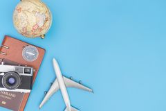 Air Travel with globe and objects on blue. Copy space Stock Photo